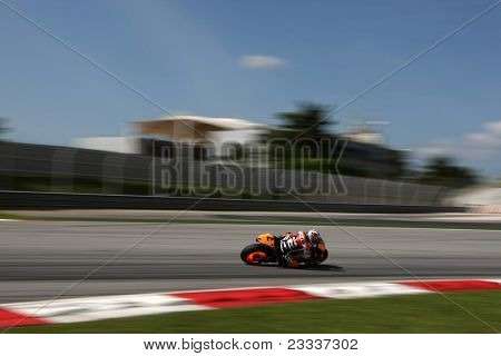 SEPANG, MALAYSIA - FEBRUARY 2: MotoGP rider Dani Pedroso of Repsol Honda Team practices at the 2011 MotoGP winter tests at the Sepang International Circuit. February 2, 2011 in Malaysia.