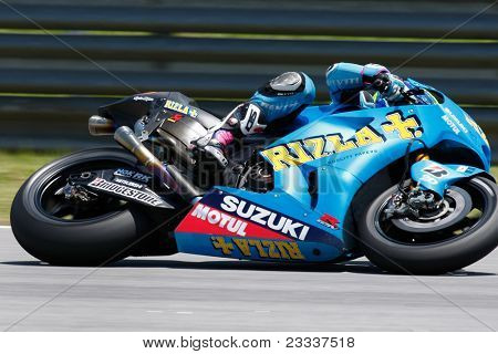 SEPANG, MALAYSIA - FEBRUARY 22: MotoGP rider Alvaro Bautista of the Rizla Suzuki Team practices at the 2011 MotoGP winter tests at the Sepang International Circuit on February 22, 2011 in Sepang, Malaysia