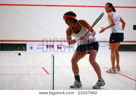 B.JALIL, MALAYSIA - MARCH 17: Rachael Grinham (Australia) plays Low Wee Wern (Malaysia) at the CIMB KL Open Squash Championship 2011 at the National Squash Centre on March 17, 2011 in B.Jalil, Malaysia.