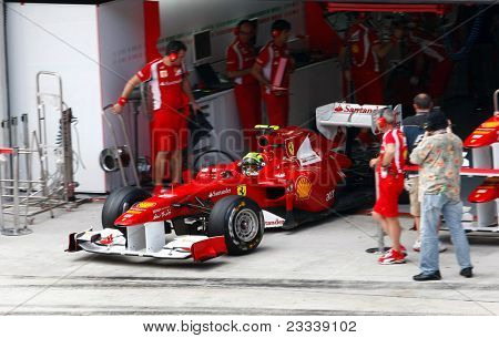 SEPANG, MALAYSIA - APRIL 8: Felipe Massa of Ferrari team leaves pit to start his practice run on the first practice session of the Petronas Malaysian F1 Grand Prix on April 8, 2011 Sepang, Malaysia.