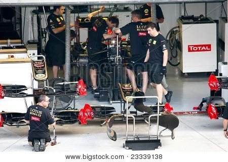 SEPANG, MALAYSIA - APRIL 8: Lotus Renault GP Team mechanics work on Vitaly Petrov's car on the first practice day of the Petronas Malaysian F1 Grand Prix on April 8, 2011 Sepang, Malaysia.