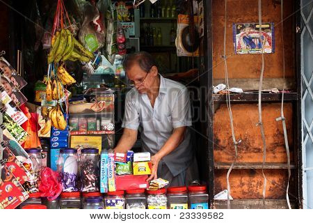 KUALA LUMPUR - MAY 22: A storekeeper watches over his traditional grocery store on May 22, 2011 in Kuala Lumpur, Malaysia. This convenience store was established just after the second world war.