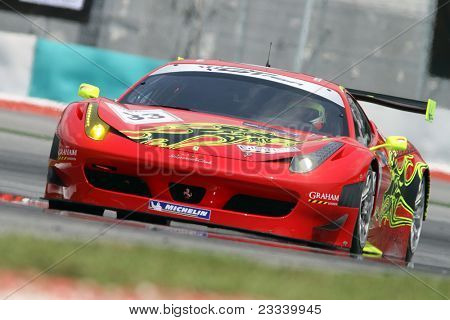 SEPANG - JUNE 17: Mok Weng Sun of Team Clearwater Racing in a Ferrari F458 takes to the tracks of the Sepang International Circuit at the GT Asia Series race on June 17, 2011 in Sepang, Malaysia.