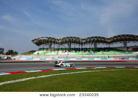 SEPANG - JUNE 19: 'GSR&Studie with Team UKYO' car takes turn one of the Sepang International Circuit during the Japan SUPER GT Round 3 race on June 19, 2011 in Sepang, Malaysia.