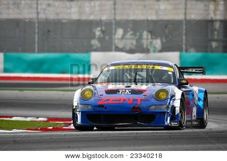 SEPANG, MALAYSIA - JUNE 19: Samurai Team Tsuchiya's Porsche 911 car takes turn 1 of the Sepang Circuit during a practice session of the Japan SUPER GT Round 3 race on June 19, 2011 in Sepang, Malaysia.