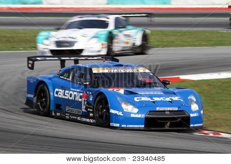 SEPANG, MALAYSIA - JUNE 19: The Nissan GTR R35 car of Team IMPUL accelerates into turn 2 of the Sepang International Circuit in the Japan SUPER GT Round 3 race on June 19, 2011 in Sepang, Malaysia.