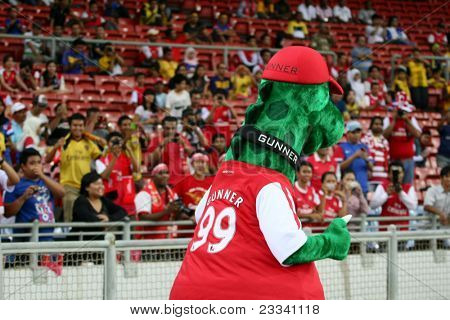 BUKIT JALIL, MALAYSIA - JULY 13: Arsenal's mascot leads the cheer at the Arsenal vs Malaysia game on July 13, 2011 at the Stadium Bukit Jalil, Malaysia. English league team Arsenal is on an Asia Tour.