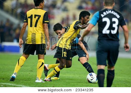 BUKIT JALIL - JULY 13: K. Gurusamy (15) dribbles past Arsenal's Samir Nasri in a friendly match on July 13, 2011 in Stadium Bukit Jalil, Malaysia. English Premier League team Arsenal beat Malaysia 4-0
