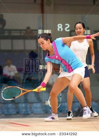 KUALA LUMPUR - JULY 20: Jenny Duncalf (blue), WISPA Rank 2, returns the ball during her match against Low Wee Wern at the CIMB Malaysian Open Squash 2011 on July 20, 2011 in Kuala Lumpur, Malaysia.