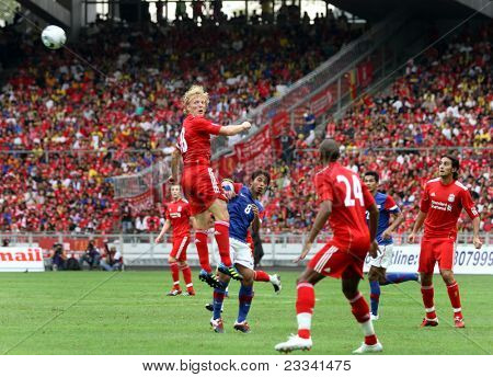 BUKIT JALIL- JULY 16: Liverpool's Dirk Kuyt heads the wall watched by David Ngog (24) in their game against Malaysia at the National Stadium on July 16, 2011, Bukit Jalil, Malaysia. Liverpool won 6-3.