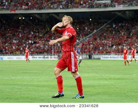 BUKIT JALIL, MALAYSIA - JULY 16: Liverpool's Dirk Kuyt celebrates after scoring against Malaysia in this game played at the National Stadium on July 16, 2011, Bukit Jalil, Malaysia. Liverpool won 6-3.