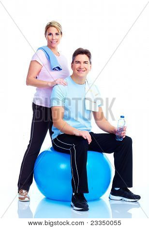 Happy smiling Fitness  couple. Over white background