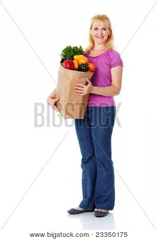 Young smiling woman with vegetables. Isolated over white.