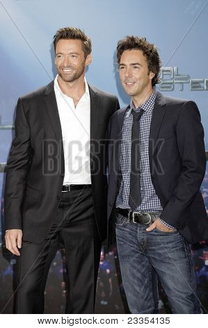MUNICH - SEPT 12: Hugh Jackman; Shawn Levy at the Real Steel photocall at Hotel Bayerischer Hof on September 12, 2011 in Munich, Germany