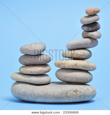 a pile of zen stones on a blue background