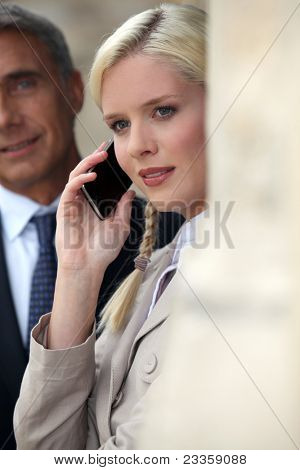 Young woman pensive on phone