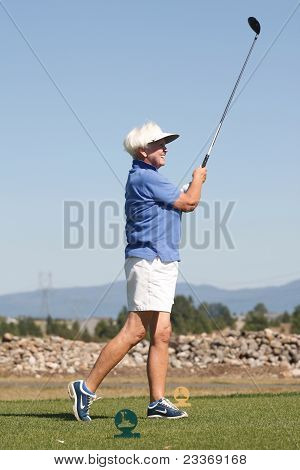 Senior Citizen Teeing Off.