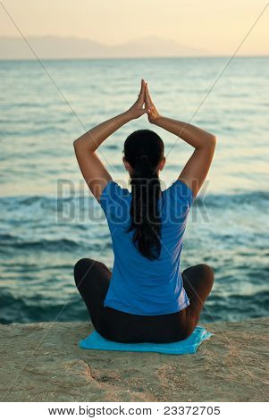 Back Of Woman Doing Yoga At Sea