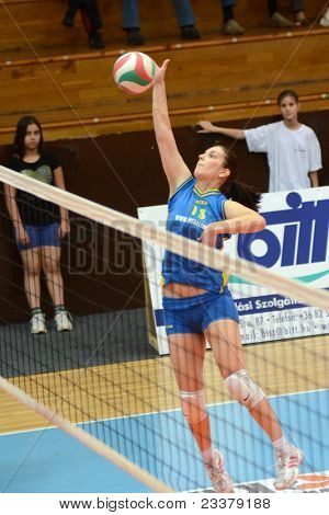 KAPOSVAR, HUNGARY - APRIL 24: Gabriella Kondor in action at the Hungarian NB I. League woman volleyball game Kaposvar (blue) vs Ujbuda (black), April 24, 2011 in Kaposvar, Hungary.
