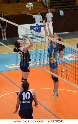 KAPOSVAR, HUNGARY - APRIL 24: Zsofia Harmath (R) in action at the Hungarian NB I. League woman volleyball game Kaposvar (blue) vs Ujbuda (black), April 24, 2011 in Kaposvar, Hungary.