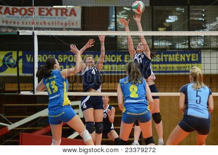 KAPOSVAR, HUNGARY - APRIL 24: Gabriella Kondor (blue 13) in action at the Hungarian NB I. League woman volleyball game Kaposvar (blue) vs Ujbuda (black), April 24, 2011 in Kaposvar, Hungary.