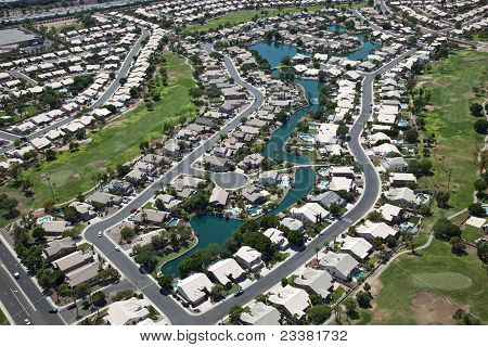 Suburban community with man made lakes and golf course