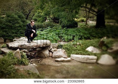 Man Looking Into Creek