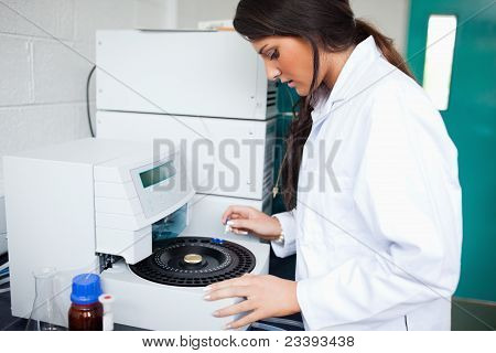 Scientist Using A Centrifuge