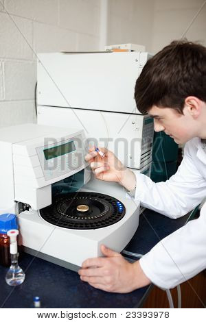 Male Laboratory Assistant Using A Centrifuge