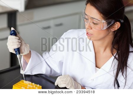 Brunette Woman Making An Experiment