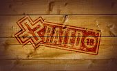 pic of x-rated  - X Rated impression on wooden crate background - JPG