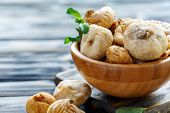 Wooden Bowl With Dried Figs. poster
