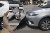 Hand Holding Smart Phone Take A Photo At The Scene Of A Car Crash, Car Accident For Insurance. poster