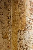 Background of rusty iron surface with rivets poster