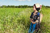 stock photo of hmong  - asian hmong girl on rice paddy in traditional costume - JPG