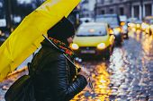 Woman Cross Street In Rainy Weather With Yellow Umbrella. Cars On Background. Copy Space. poster