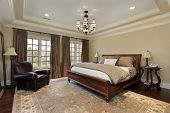 stock photo of master bedroom  - Master bedroom in luxury home with tray ceiling - JPG