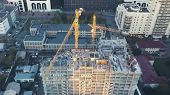 Busy Construction Site And Construction Equipment Aerial. Real Construction Site Industrial Skyscrap poster