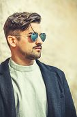 Cool Handsome Young Man With Modern Hairstyle. Fashion And Stylish Man With Sunglasses. A Charming A poster