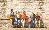 Group Of Happy Excited Friends Having Fun Outdoor Cheering With Guitar - Young People Enjoying Sprin poster