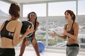 Smiling Sporty Women With Medicine Ball Exercising In Fitness Studio. Three Diverse Female Friends W poster