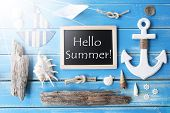 Flat Lay Of Chalkboard On Blue Wooden Background. Sunny Nautic Or Maritime Summer Decoration As Holi poster