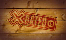 picture of x-rated  - X Rated impression on wooden crate background - JPG