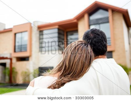 Loving couple looking at their dream house