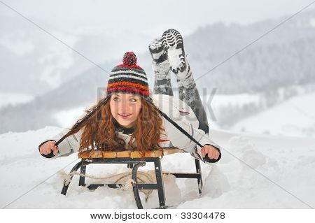 Pretty Girl  Riding On A Sled