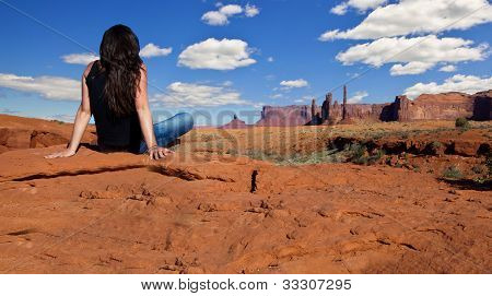 Female Looking Out Into The Vast Monument Valley