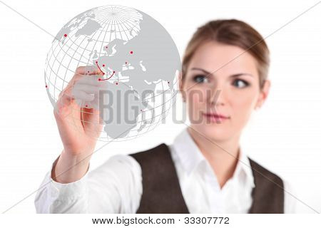 Young business woman drawing on glass