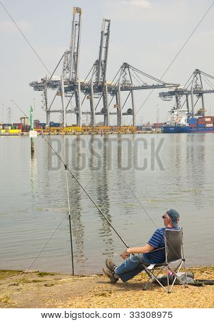 Fisherman by the harbor