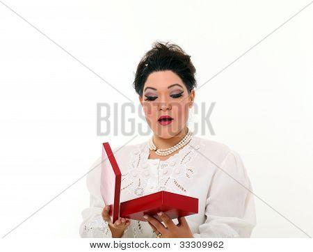 Pretty Plus Size Woman Open A Gift