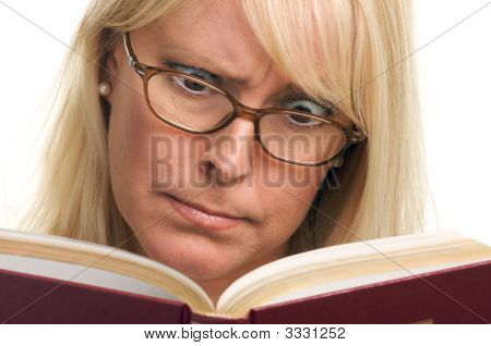 Attractive Woman Bewildered While Reading